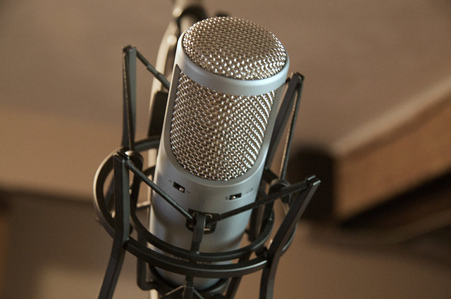 "Close up of professional microphone. Photo titled ""Microphone"" licensed under Creative Commons Attribute license under Matthew Keefe."